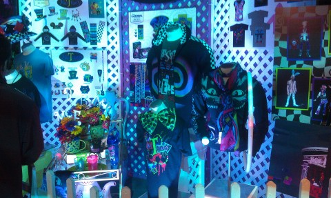 A display with concept art and merchandise for the Mad T Party