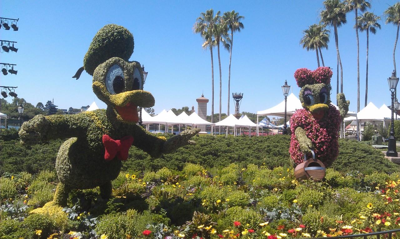 Donald and Daisy as you enter World Showcase.