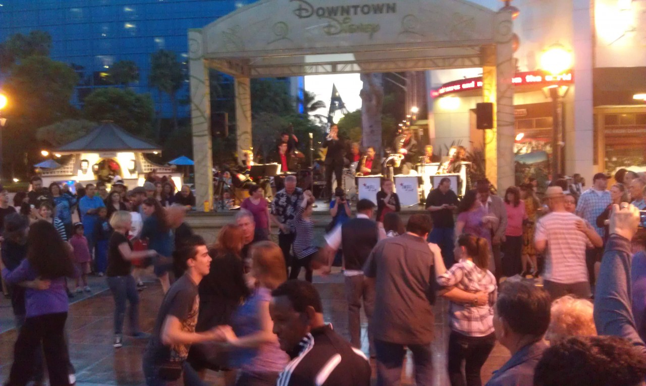 A fair number of guests out swing dancing in Downtown Disney.