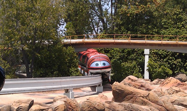 Monorail Mona (orange) entering the park.  FYI Manny (red) has audio issues and is cycling but not loading.
