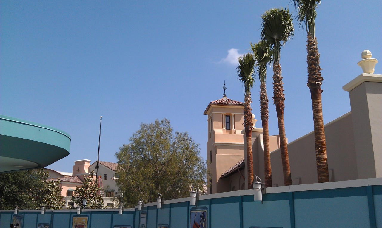 Only 4 weeks till the Grand Opening.  Buena Vista Street from near the entrance.  Notice the new trees and flag pole.