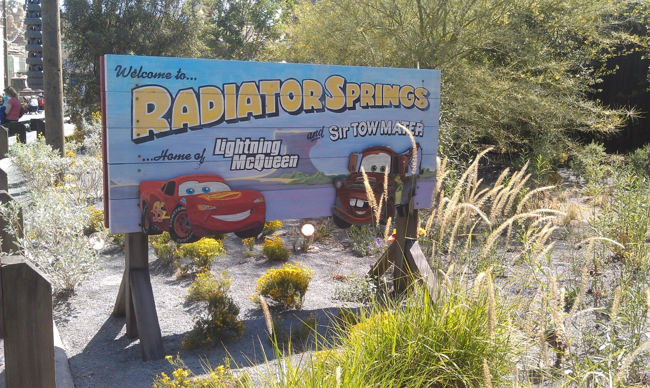 An entrance sign for #CarsLand from BugsLand