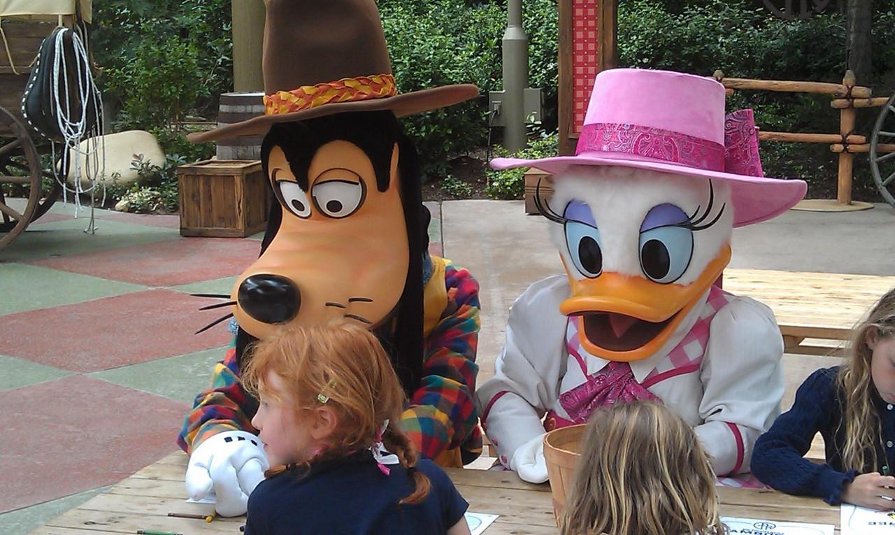 Goofy and Daisy coloring at the Big Thunder Ranch Jamboree