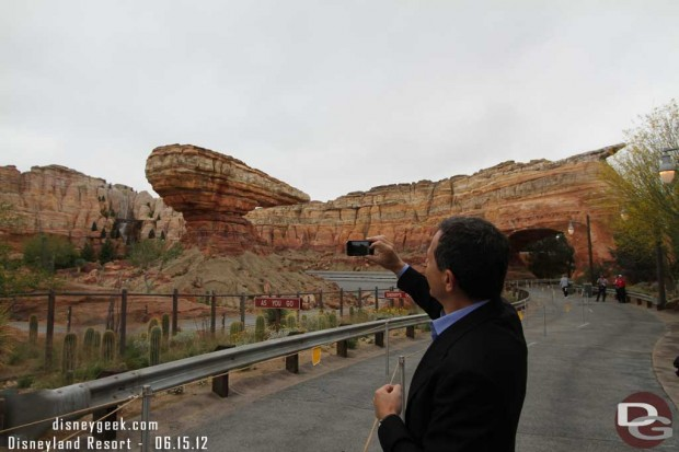 Bob Iger taking a picture of Radiator Springs Racers