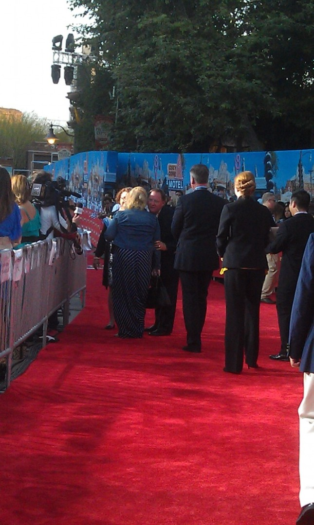 John Lasseter slowly making his way down the red carpet.
