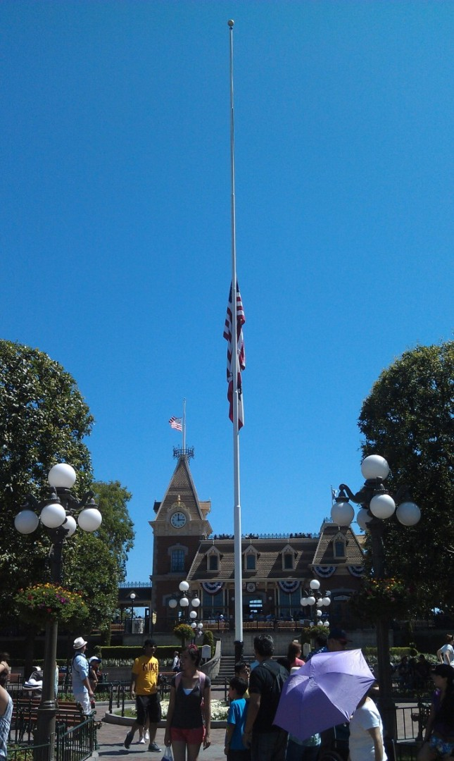 Disneyland flags are at half staff today to honor the victims of the shootings in Colorado.
