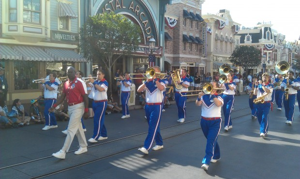 The All American College Band leading a march down Main Street before the nightly flag retreat.