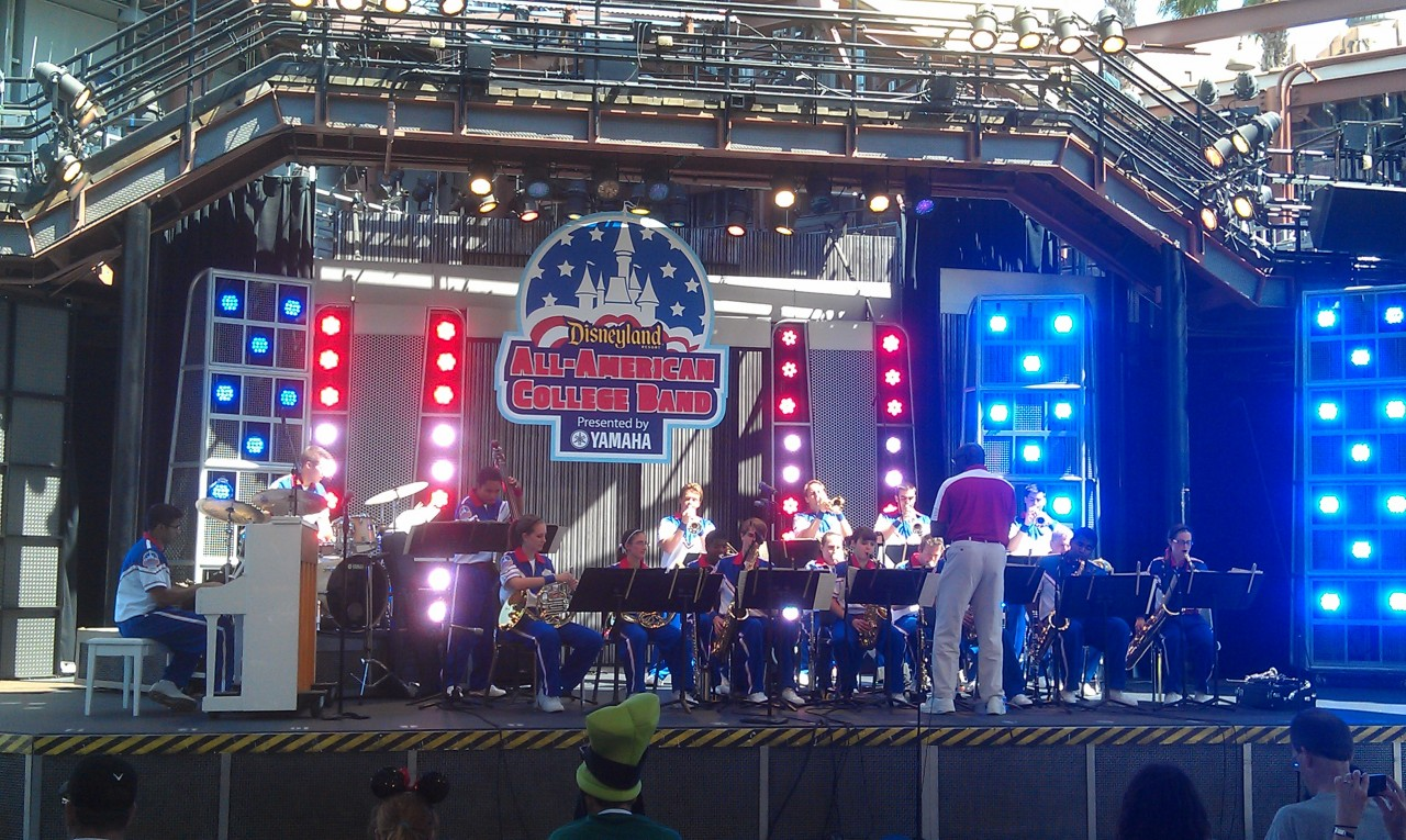 The All American College Band performs a set on the Hollywood Land Backlot stage at 3:25pm