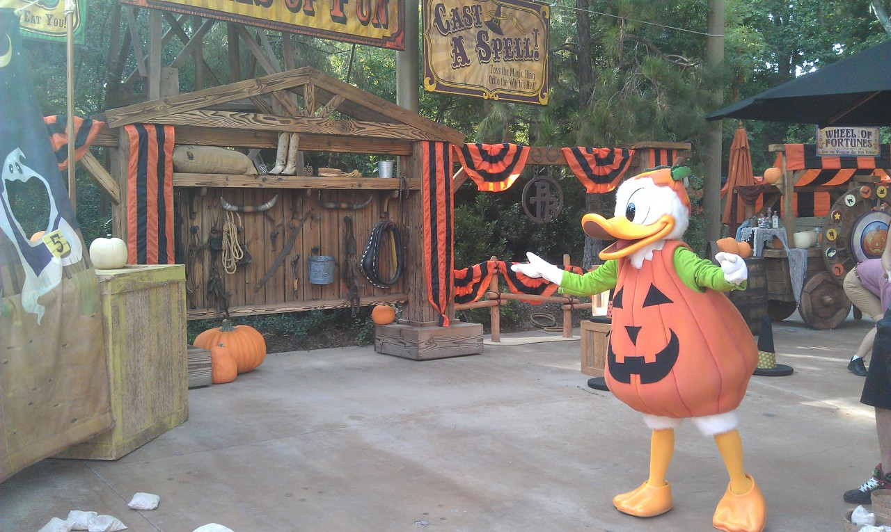 Donald trying the Hungry Ghouls game in the Halloween Carnival