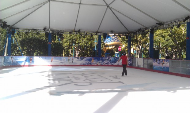 A couple cast members skating on the new ice rink in Downtown Disney