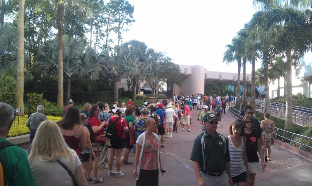 The line for #Epcot30 merchandise stretches past Spaceship Earth