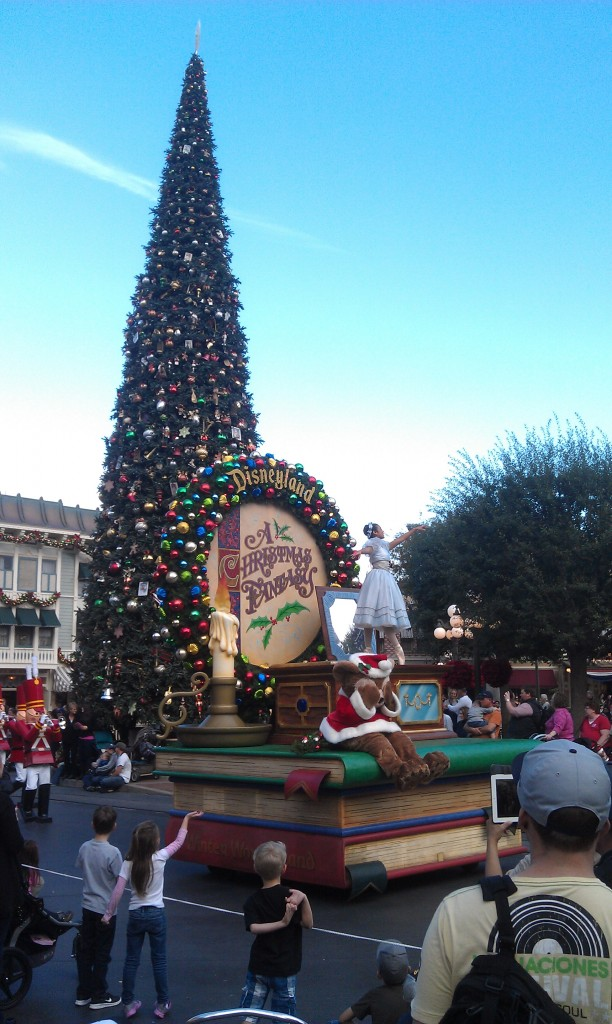 A Christmas Famtasy Parade arriving in town square.
