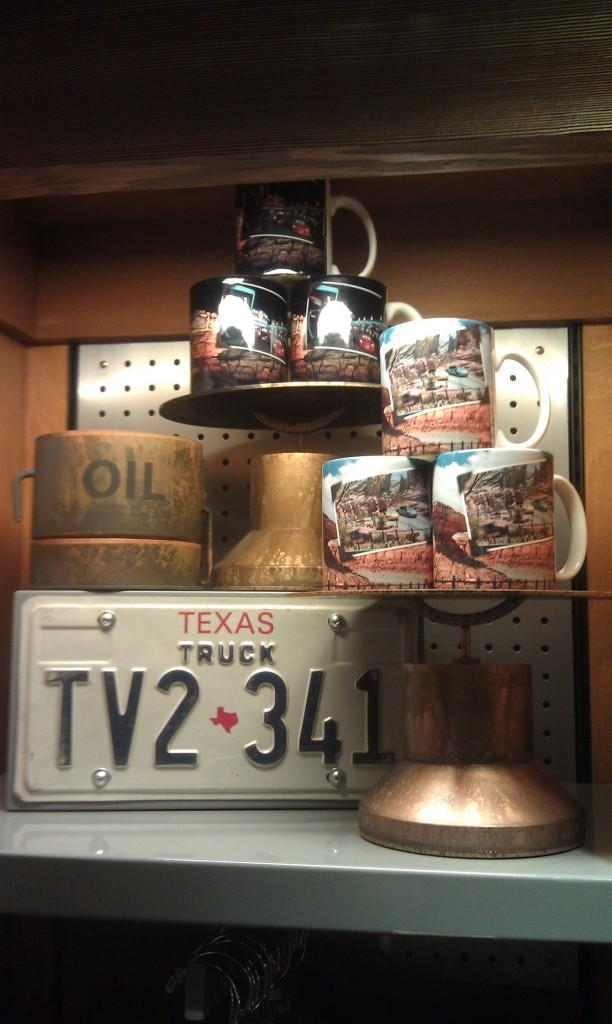 A merchandise display, #CarsLand photo mugs