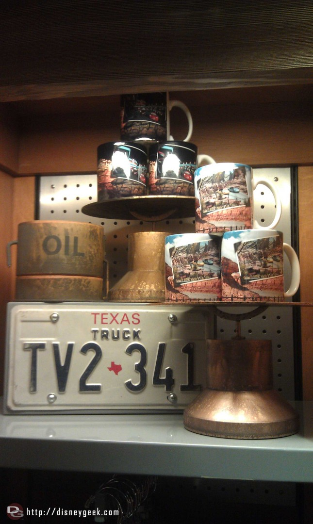 A merchandise display, #CarsLand photo mugs