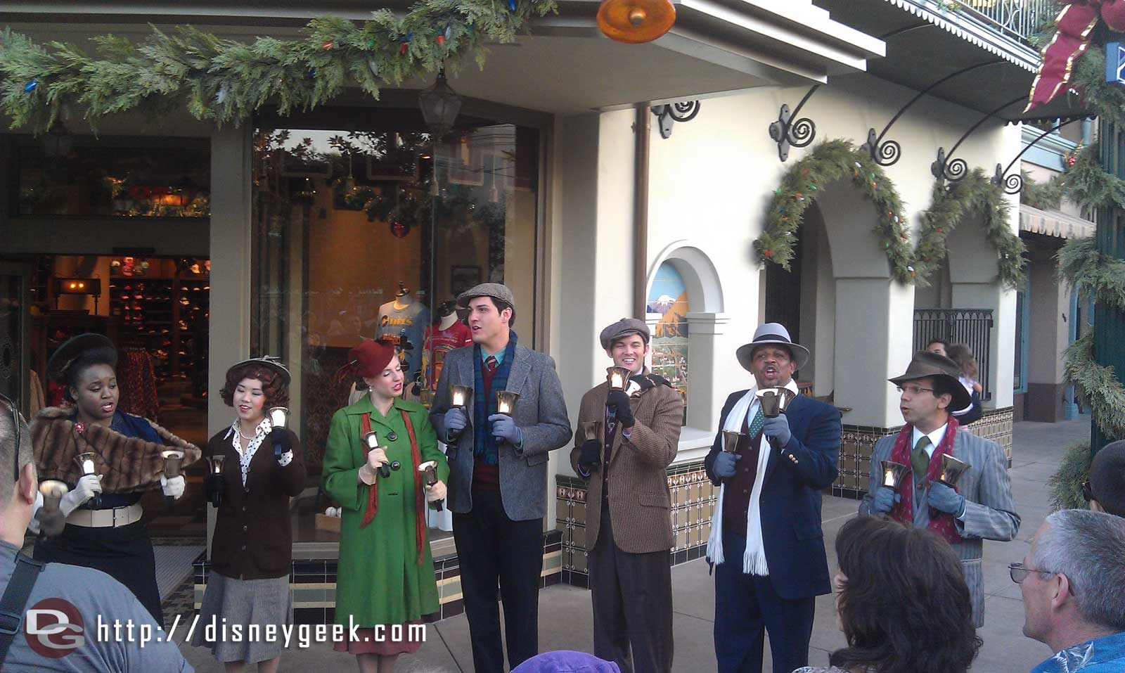 The Buena Vista Street Community Bell Ringers performing in front of the Los Feliz Five & Dime