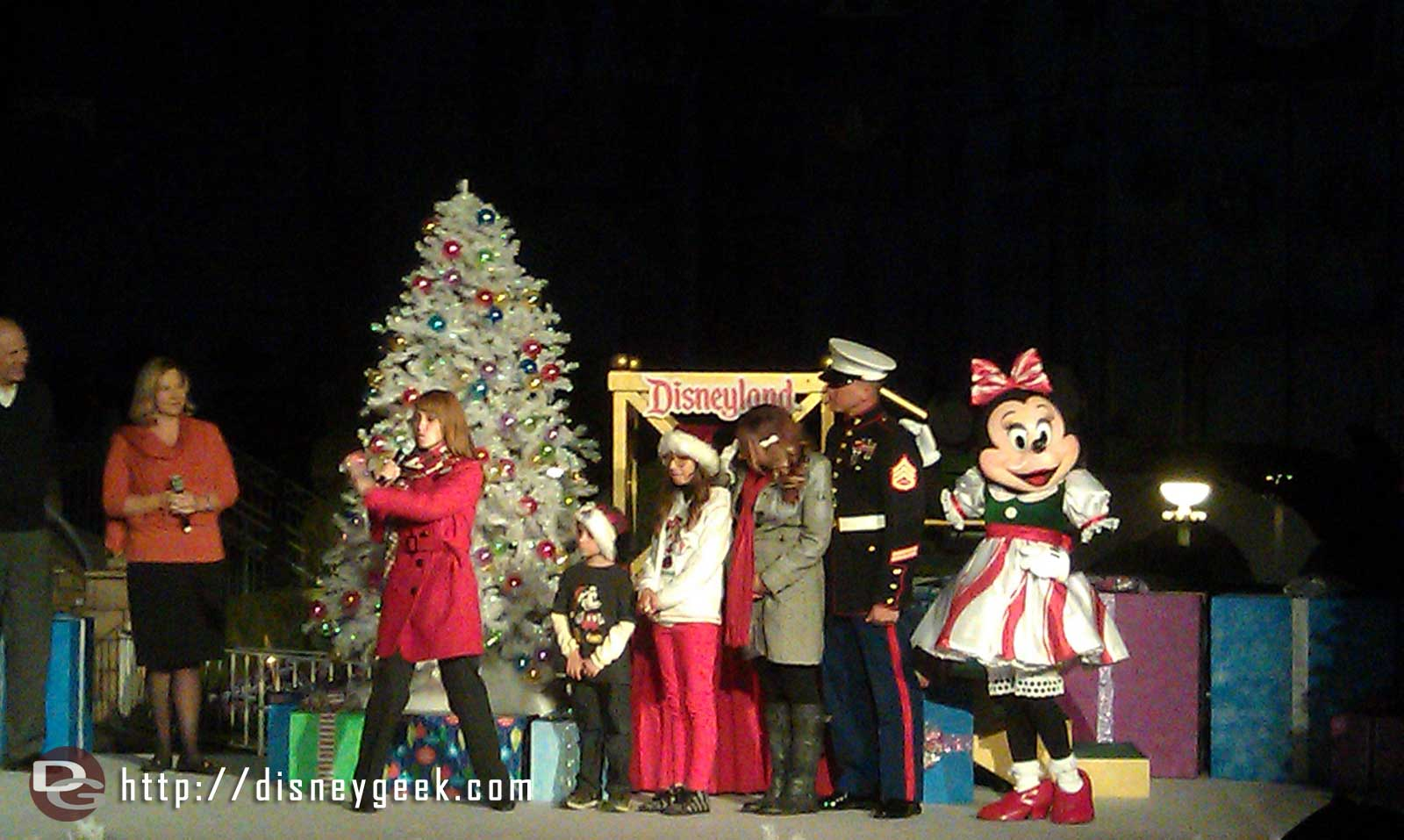 The Plummer family and Minnie arrive to light Small World
