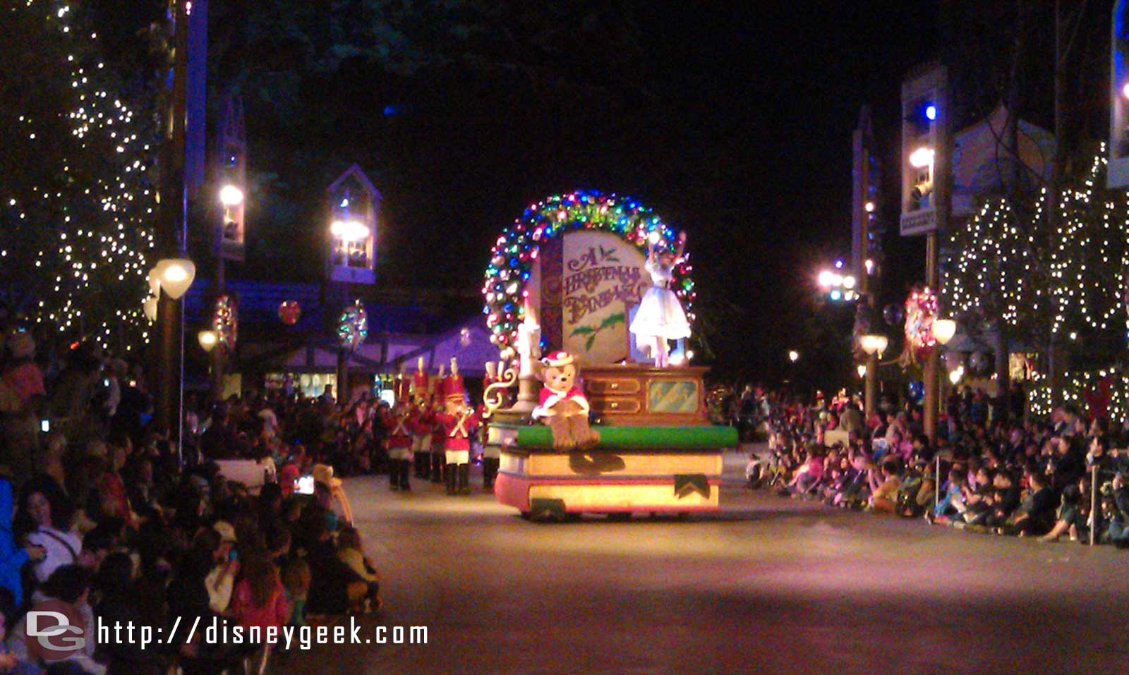 The first Christmas Fantasy parade of the year making its way toward Small World