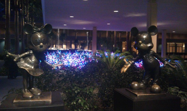 The flowerbeds around the fountains in front of the Fantasy Tower are full of lights.