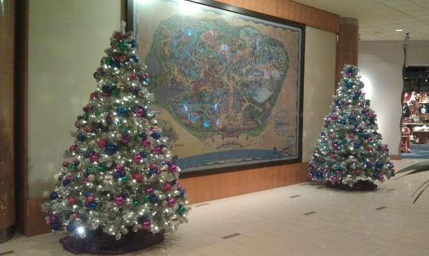 Two trees flank the Disneyland map in the Fantasy Tower lobby.