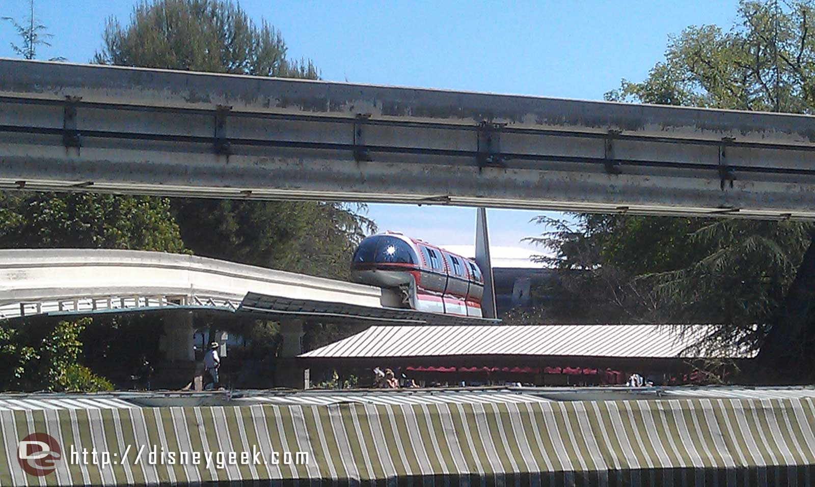 Monorail Orange was stopped near Small World mall, now going backwards with guests onboard, guessing back to DD