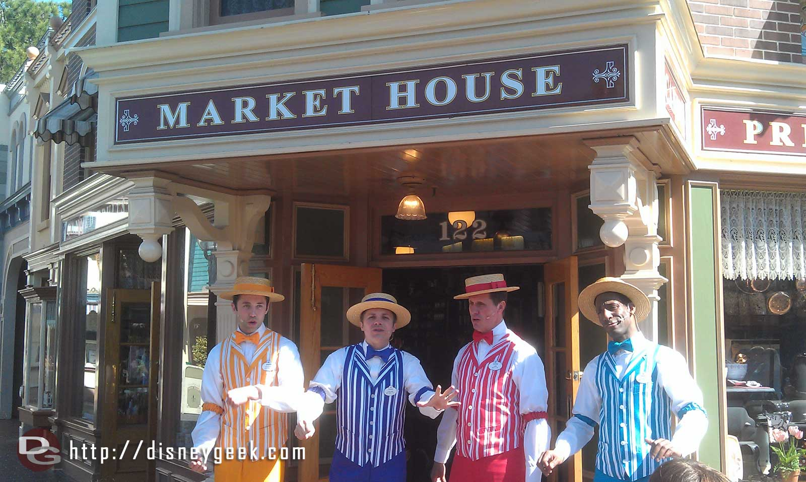 The Dapper Dans of #Disneyland performing on Main Street in front of the Market House