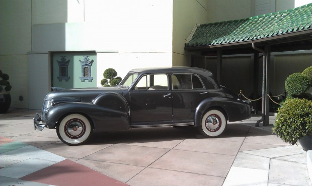 An old Cadillac out front of the Chinese Theater