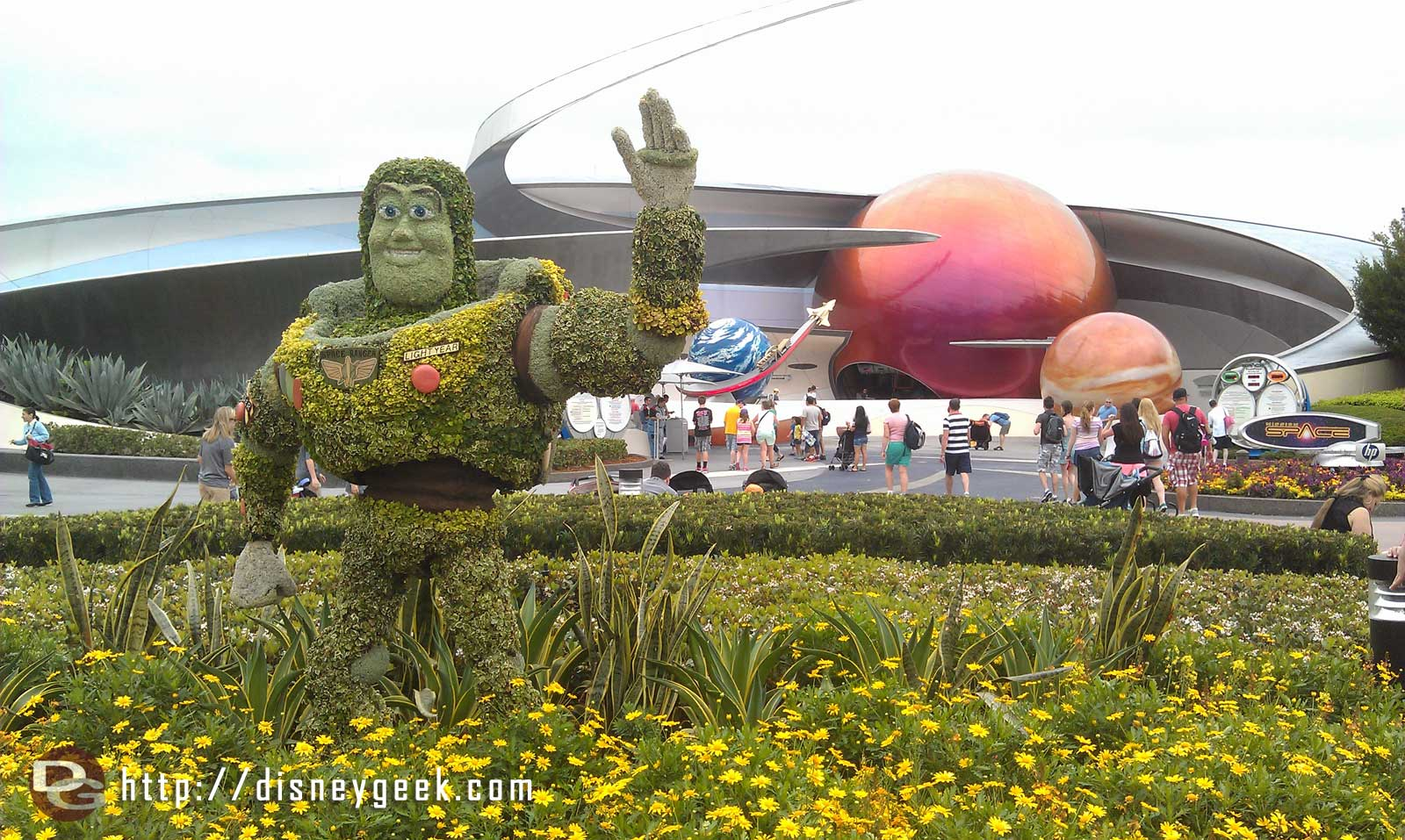 Buzz topiary out front of Mission Space