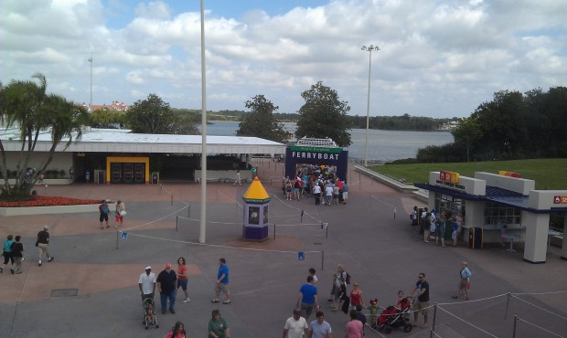 Looks like the Magic Kingdom may be crowded.  Ferry boat line to the sign and monorail down the ramp