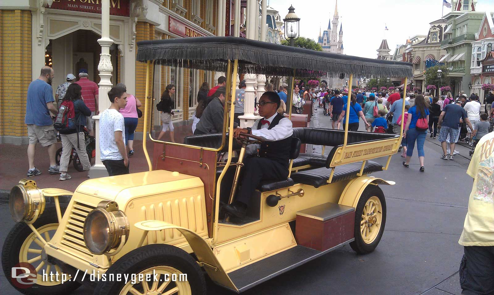 Main Street transportation, two cars and a trolley out