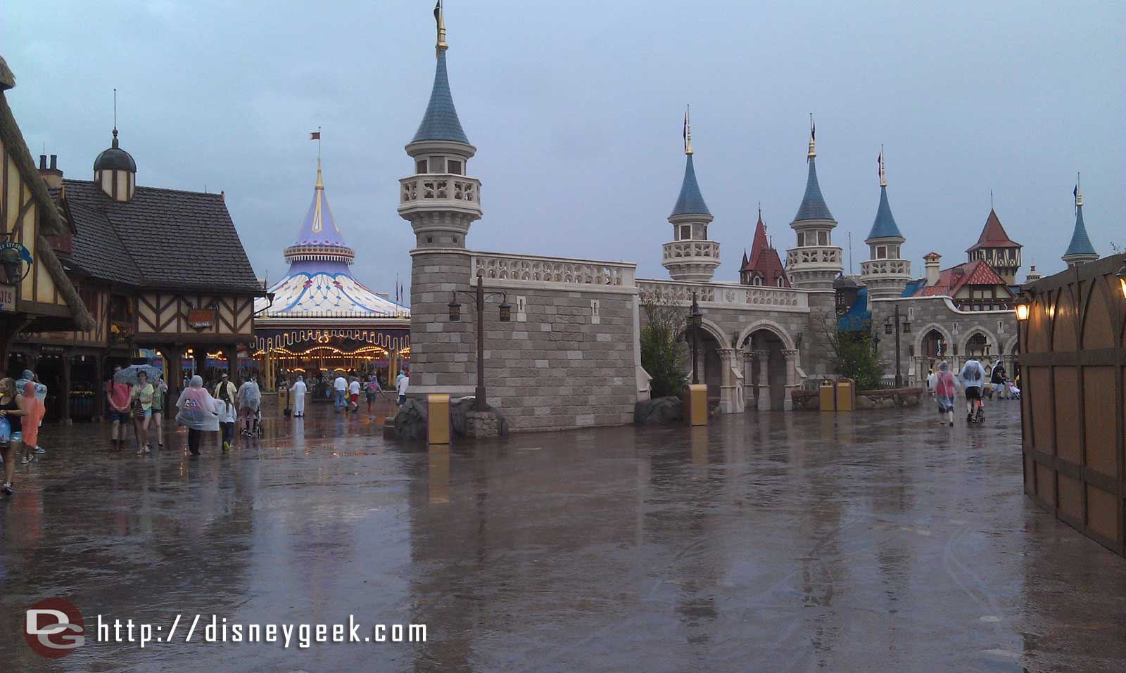 Venturing out since the rain seems a steady, light drzzle.  Walking through Fantasyland
