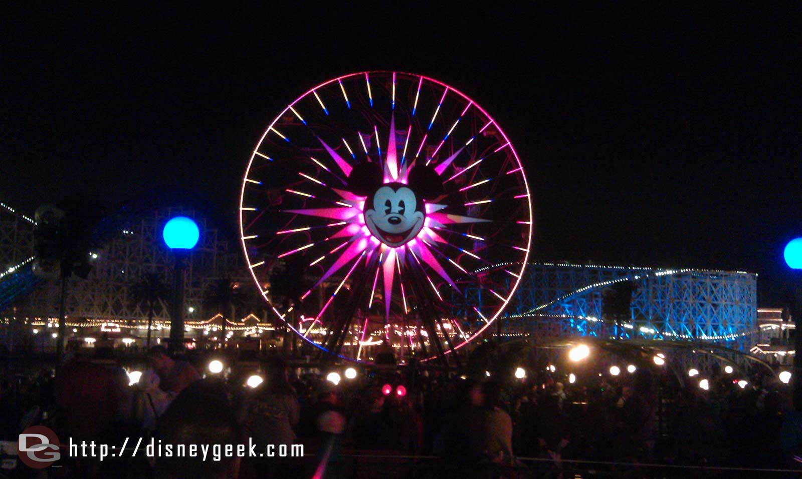 Waiting for World of Color, Mickey's Fun Wheel across Paradise Bay