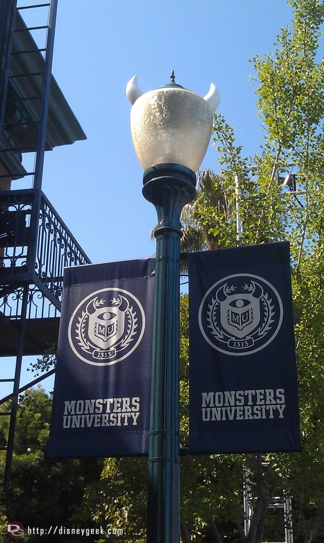 A couple banners for Monsters University, notice the light post