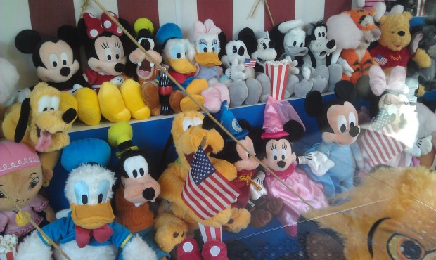On #BuenaVistaStreet the Big Top Toys window has some flags as do several of the others