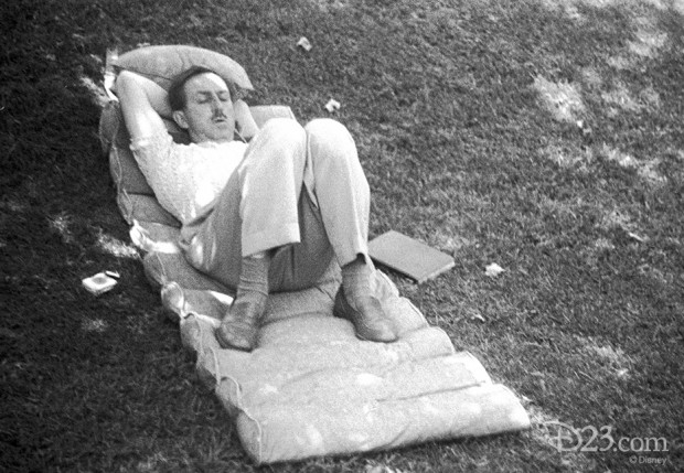 """This never-before-released photo, taken with Walt's personal camera, show Walt sleeping in the shade on the lawn of his Woking Way home on a state-of-the-art '40-s cushion—a book at his side. From the """"D'scovered"""" feature exclusively on D23.com."""