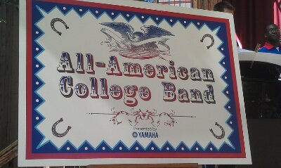 A sign for the All-American College Band at Woody's All-American Round-up