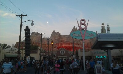 The moon rising over #CarsLand this evening as I wait for the neon to light up Route 66