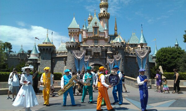 Mary Poppins and the Pearly Band in front of Sleeping Beauty Castle
