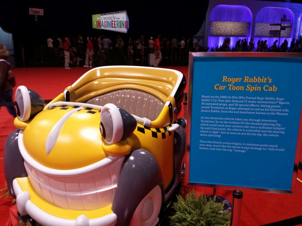 Disneyland attraction vehicles on display from Cartoon Spin #D23Expo