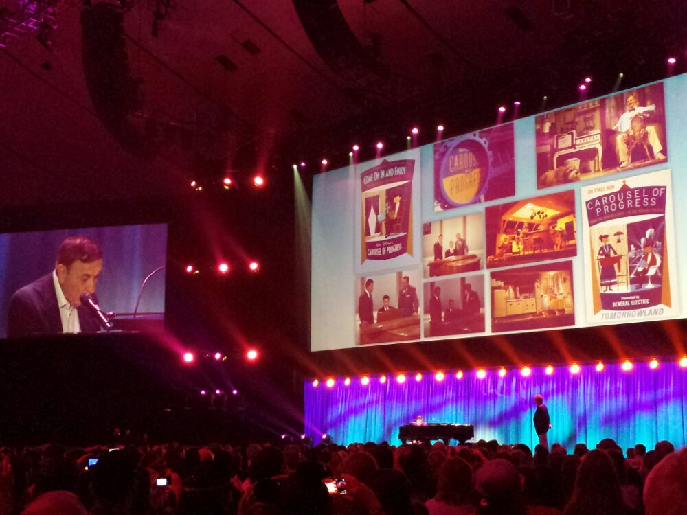 The audience is Singing along to a Great Big Beautiful Tomorrow #D23Expo