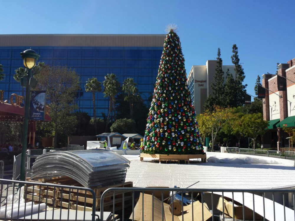 The Downtown Disney Christmas tree is up and the ice skating rink is taking shape around it