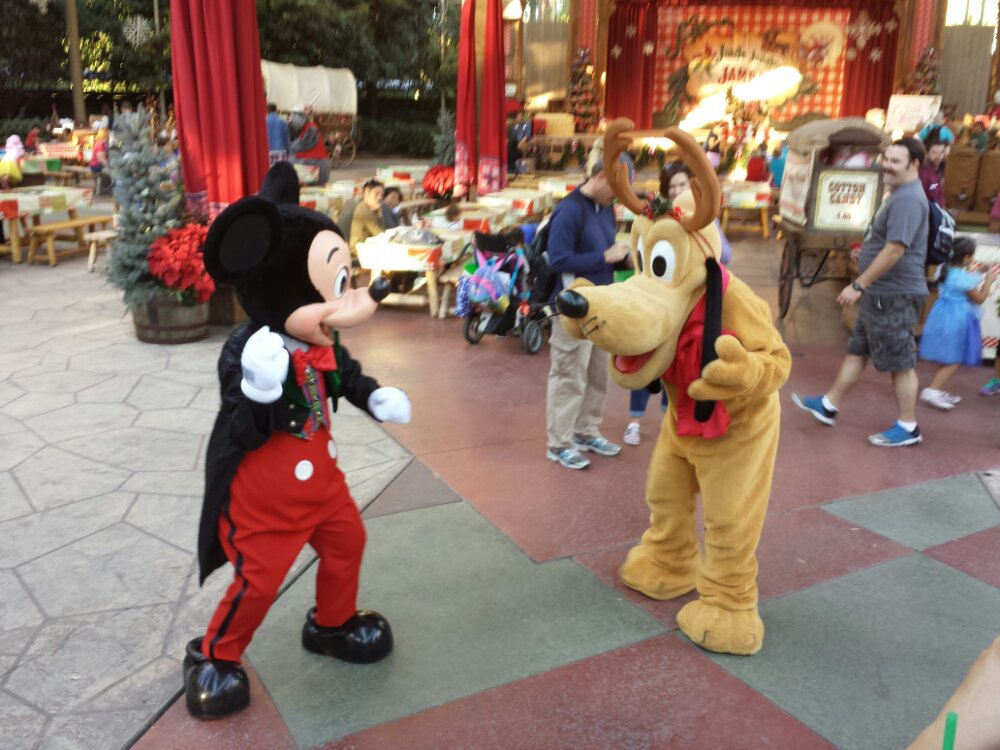 Mickey and Pluto playing around