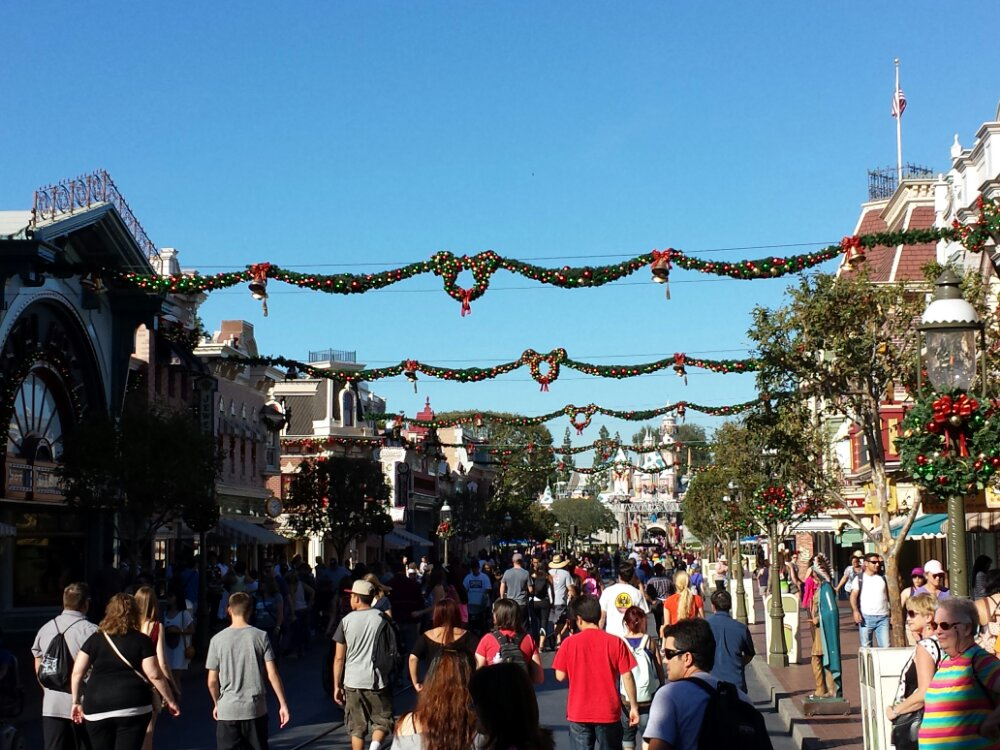 The garland is up and Mickey wreaths on Main Street USA
