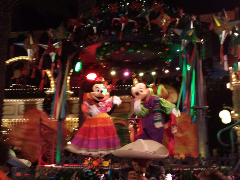 Minnie and Mickey on stage at the Viva Navidad! Street Party