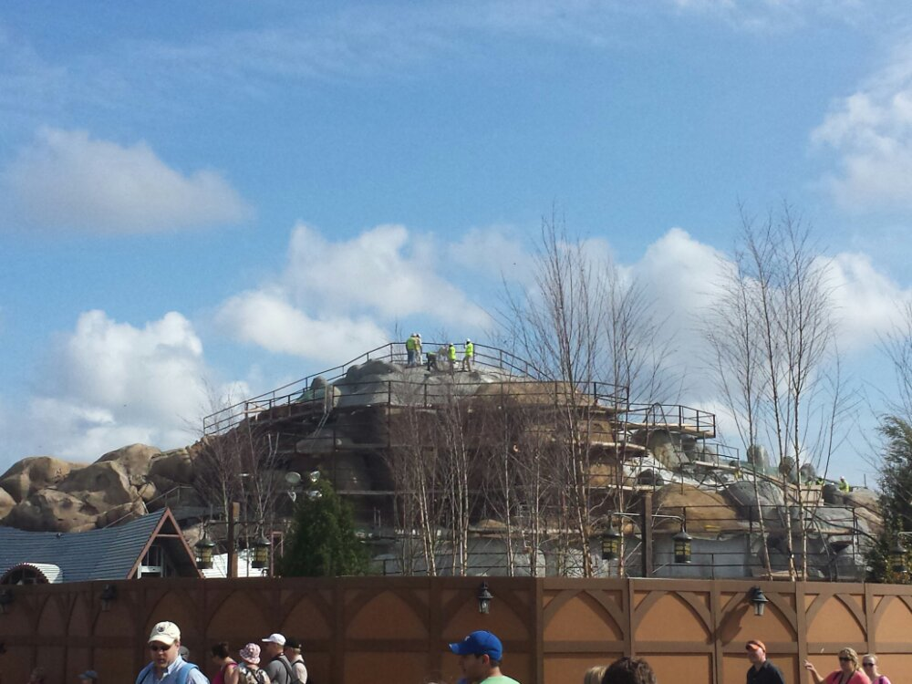 The Seven Dwarfs Mine Train is inching along, a lot more rockwork completed since April