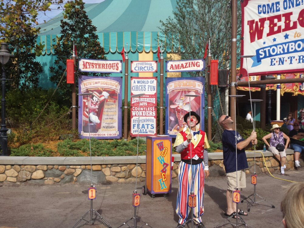 Wowzer entertaining the crowd at the entrance to Storybook Circus