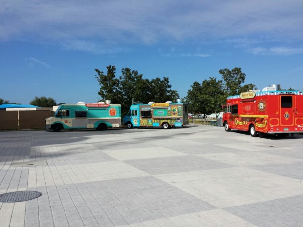 Four food trucks at the far end of the West Side