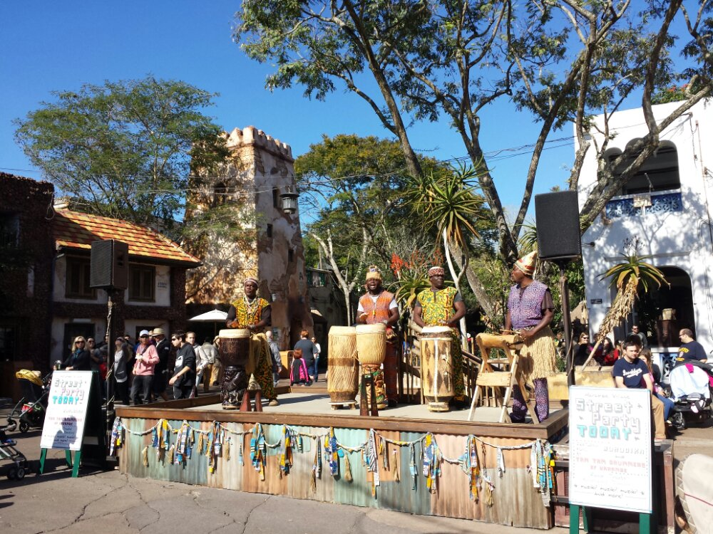 A street party in Harambe featuring the Tam Tam Drummers