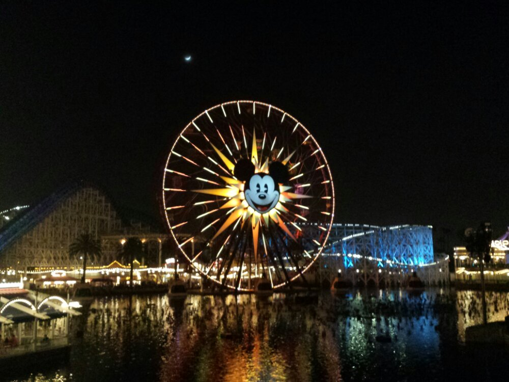 Mickey's Fun Wheel with the moon overhead