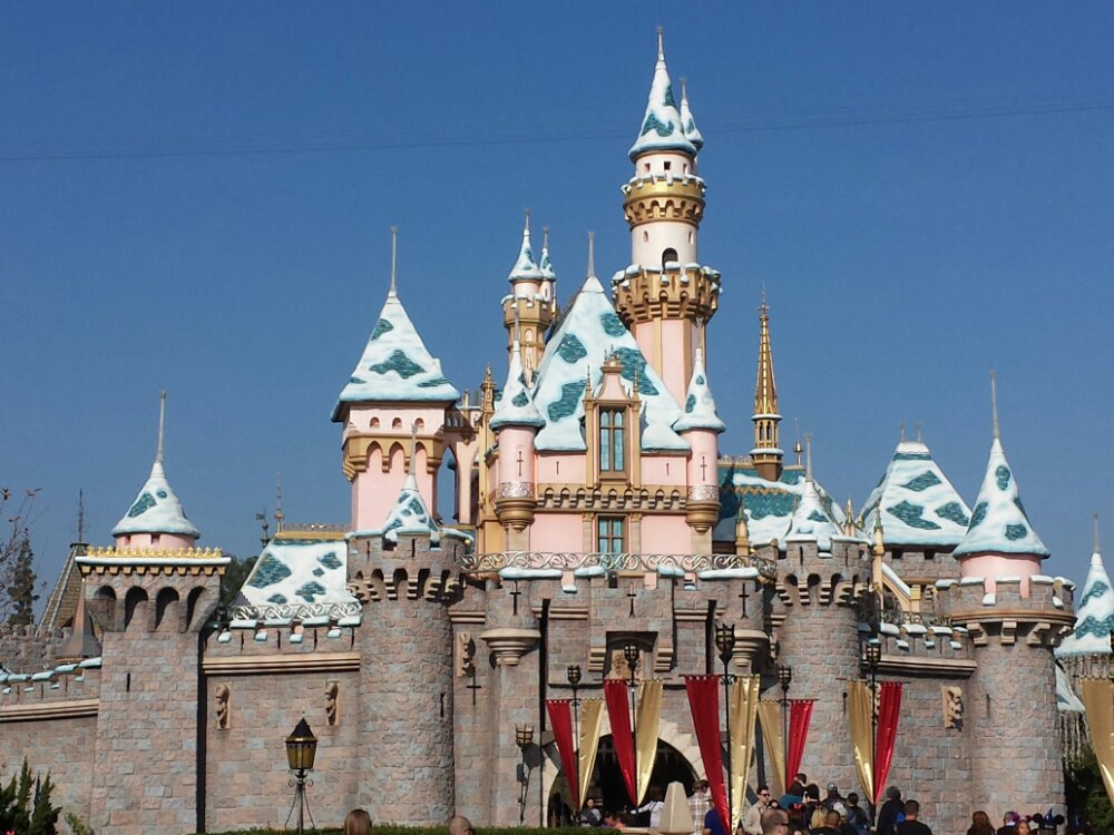 Sleeping Beauty Castle still has snow but all the lights are put away