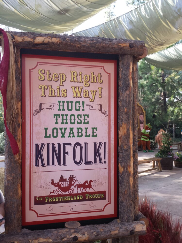 A sign for the Frontierland Troupe